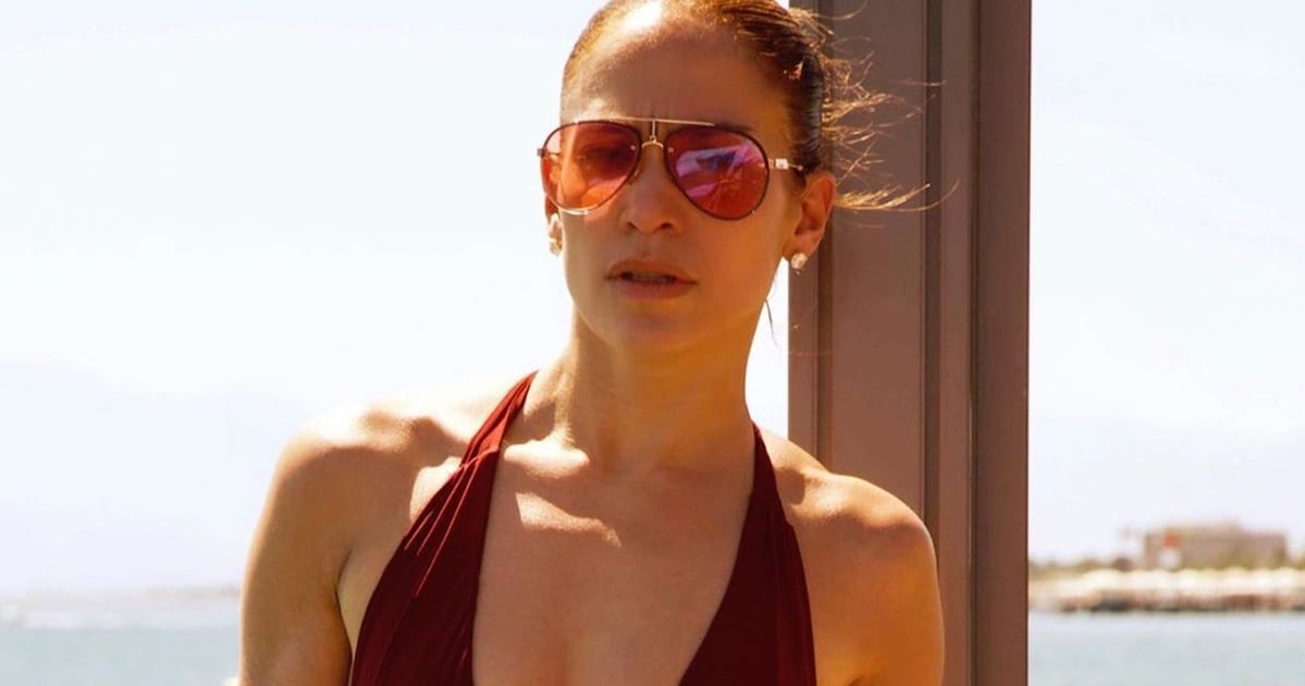 sheesh-j-lo-could-have-at-least-warned-us-before-slipping-into-this-plunging-one-piece
