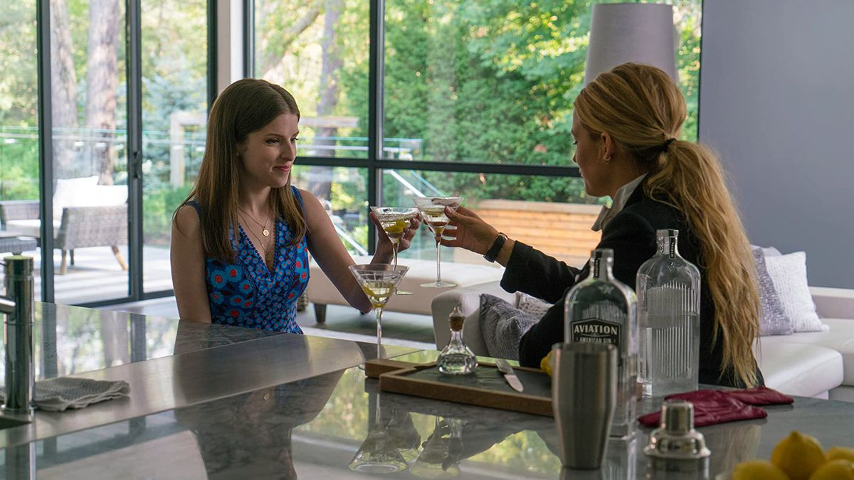 Stephanie (Anna Kendrick) and Emily (Blake Lively) share a cocktail in a screenshot from A Simple Favor