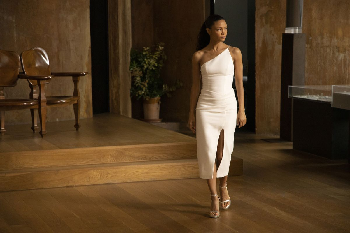 Maeve in the real world in a real white dress in Westworld season 3