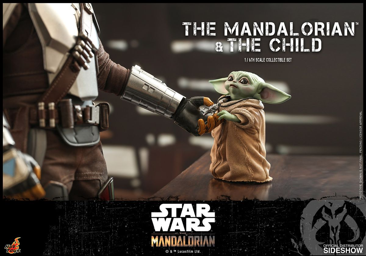 The Mandalorian is able to reach down and grab hold the the Mythosaur medallion around the tiny Baby Yoda's neck.