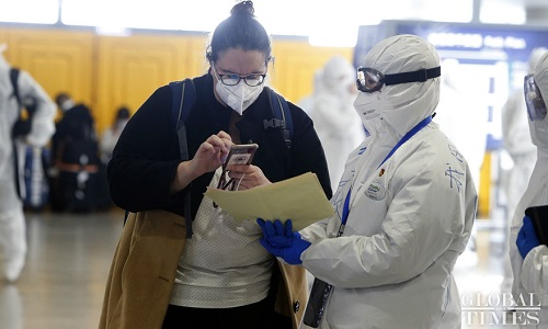 China drastically reduces worldwide flights in move to curb imported coronavirus cases