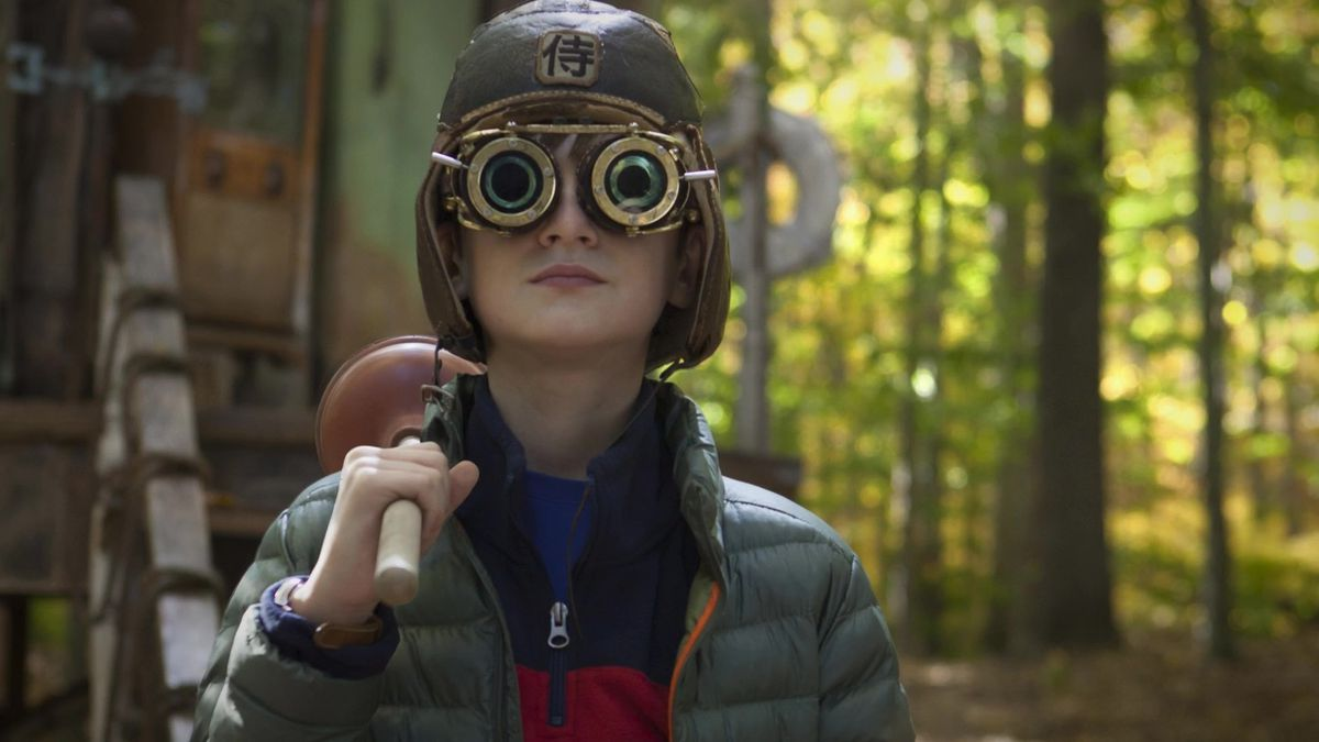 a young boy wearing goggles