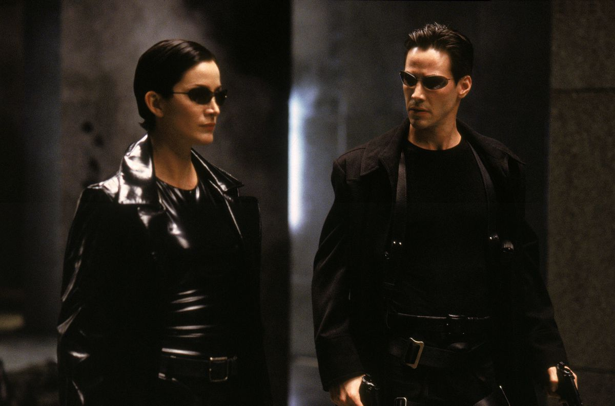 Trinity (Moss) and Neo (Reeves) prepare for battle.
