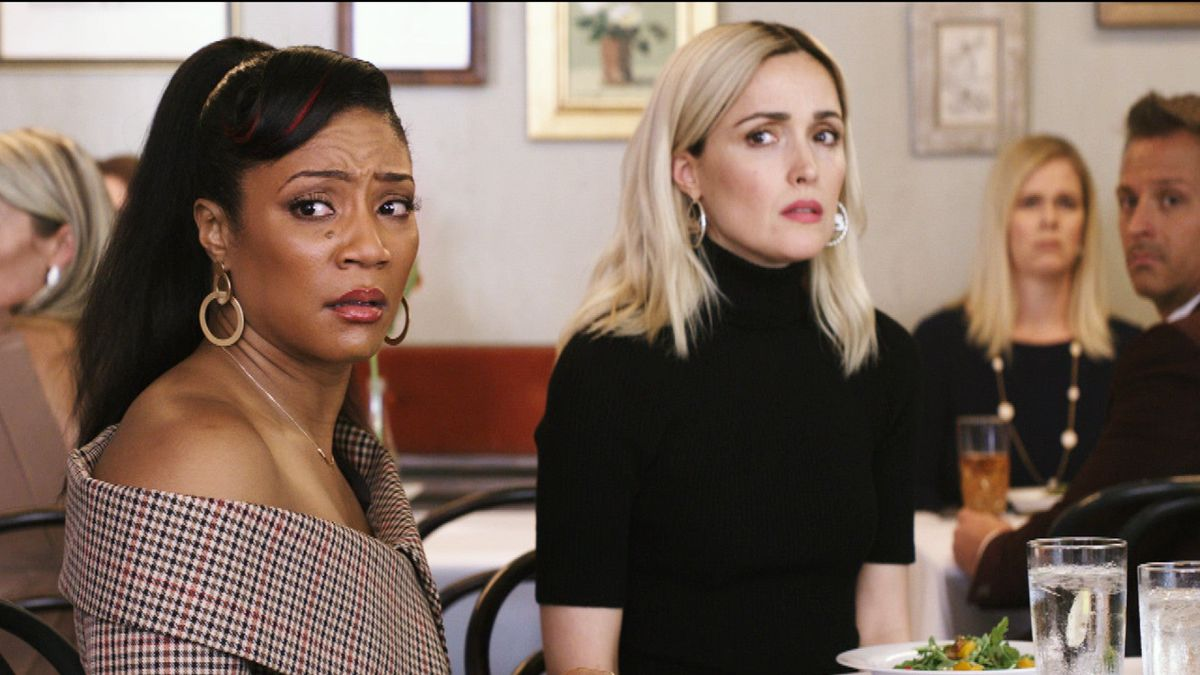 like a boss: tiffany haddish and rose byrne look scared