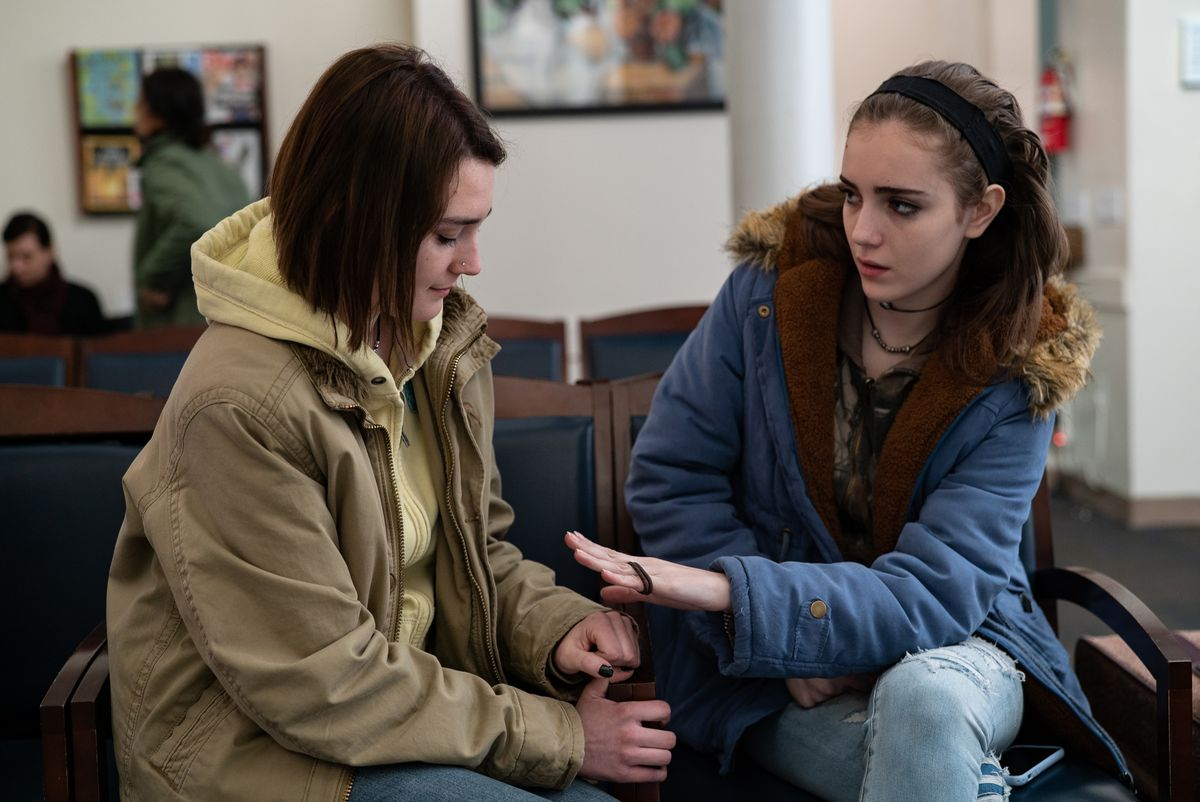 Two young women, Autumn and Skylar, sit in an abortion clinic in Never Rarely Sometimes Always