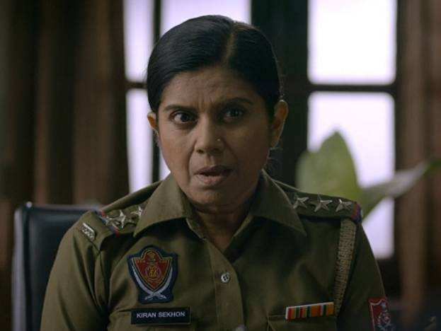 Mita Vashisht as Police Officer Kiran Sekhon